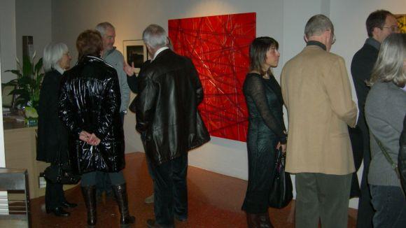 Alguns dels visitants a la galeria