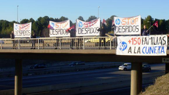 Els treballadors d'HP protesten a l'AP-7 pels darrers acomiadaments