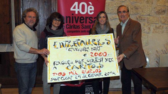Els 2.000 euros de 'Queviures d'art' arriben a Càritas