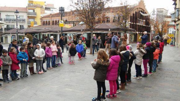 Els alumnes del Cor del Thau Sant Cugat porten les seves nadales als carrers de la ciutat