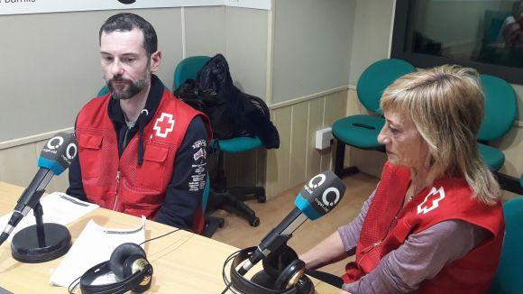 El cap de comunicació de Creu Roja, David Bea, i la voluntària Pola Pàmies