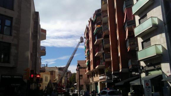 Cau part d'un balcó d'un cinquè pis del carrer de Sant Bonaventura