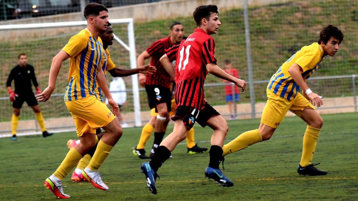 Imatge del partit entre el SantCu i l'Atlètic Sant Just / Foto: Marc Mata