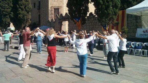 L'Entitat Sardanista ret homenatge a Sant Cugat amb l'estrena d'una sardana