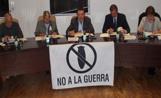 La bandera del 'No a la guerra' va presidir la darrera sessió ordinària de la Junta de Veïns de l'EMD