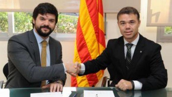 Gerard Esteva i Ivan Tibau en la signatura de l'acord  / Font: Jordi Estruch