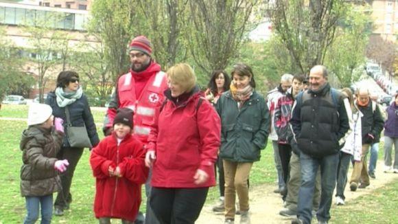 Esport i solidaritat es donen la mà amb la passejada de Creu Roja