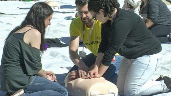 Els assistents han participat a un taller de reanimació cardiopulmonar