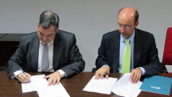 Moment de la signatura, amb Xavier Mate i Alberto Canals / Foto: UIC